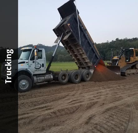 Dump trucking delivering aggregate | Trucking