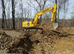 Excavator performing land clearing - 3 Brothers Excavating