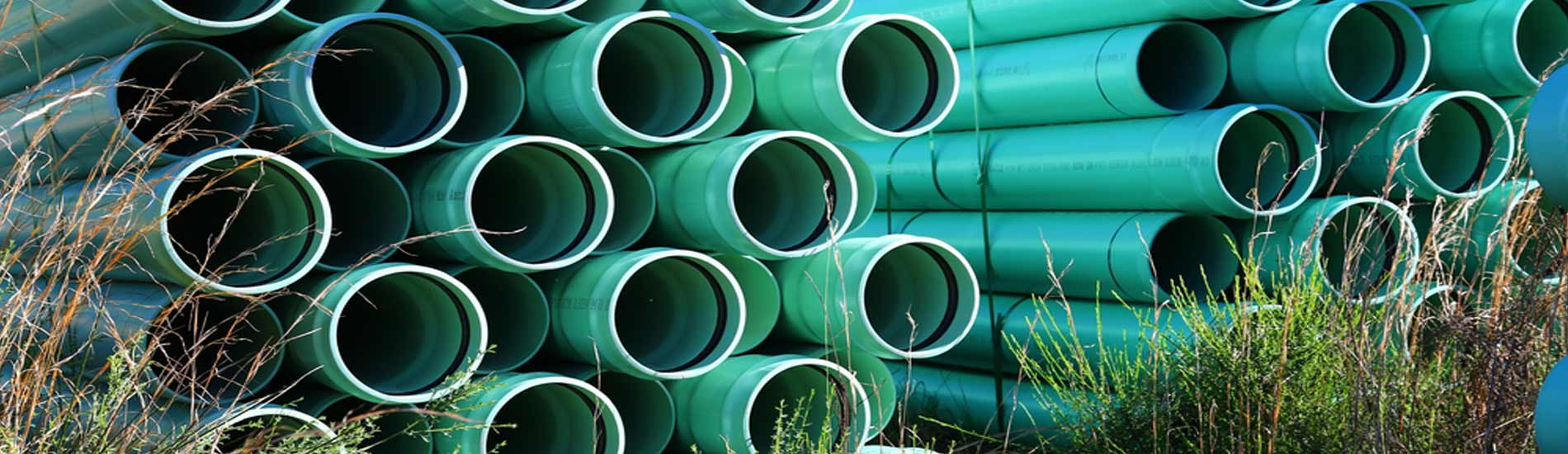 Rows and rows of stacked commercial water pipe