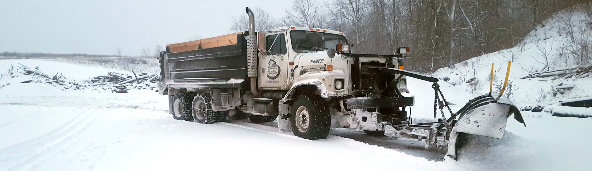 Dump truck with a snow plow attachment for commercial snow removal and road maintenance