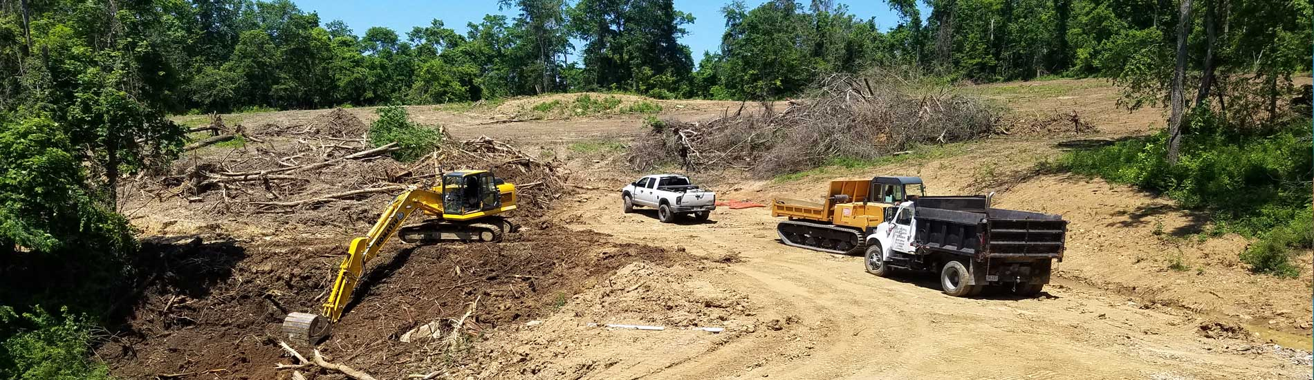 Land clearing and access road building for the exploration of crude oil / natural gas