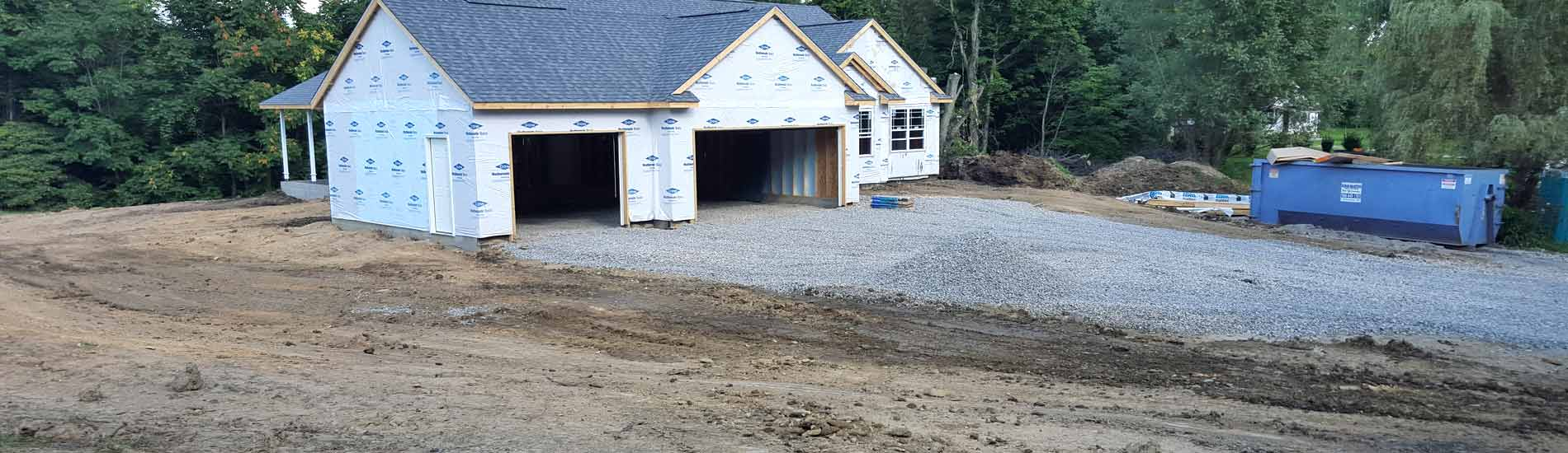 New home with final site grading and aggregate for driveway building