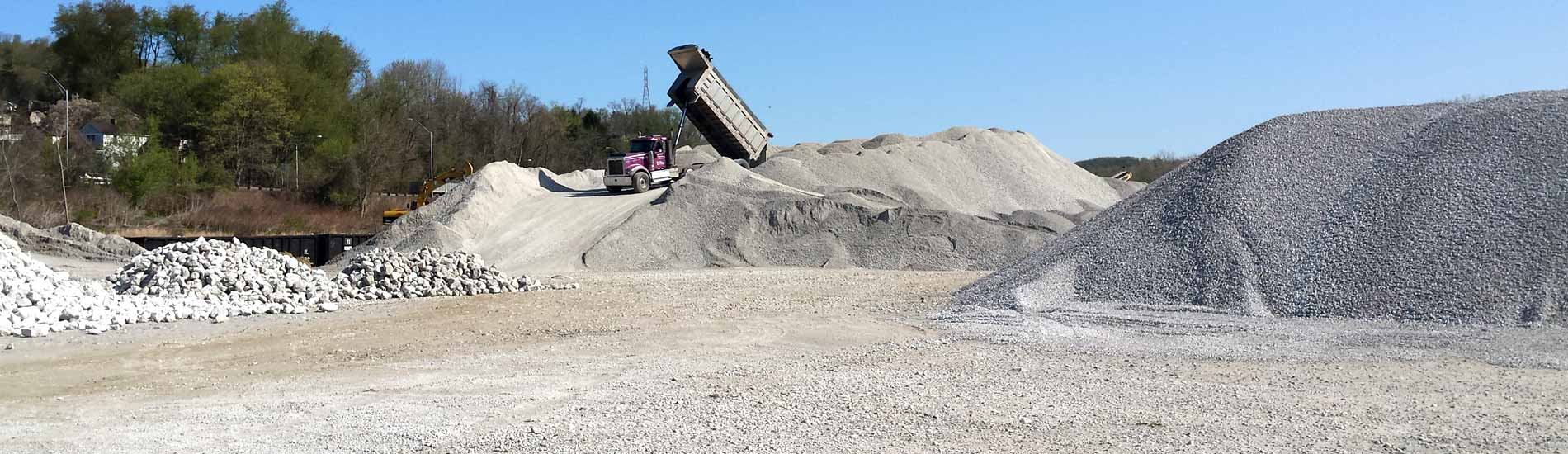 Dump truck delivering excess aggregate to a stone quarry