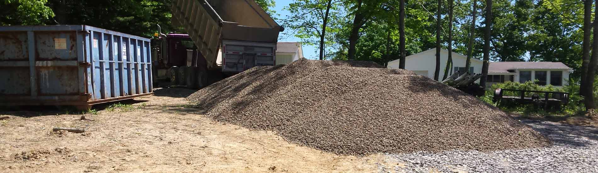 Dump truck delivering aggregate for new home construction
